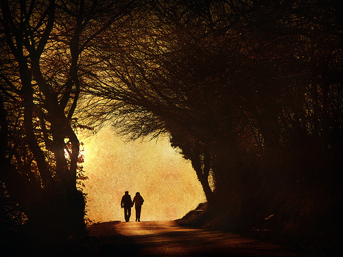 couple walking in the light
